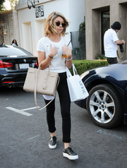 Sarah Hyland kept it comfy all the way down to her black-and-white leather sneakers.