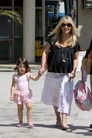 Sarah Michelle Gellar camouflaged her baby bump with a loose, flowy black top.