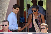 Michelle Obama spruced up her simple black tank with a colorful floral scarf during a vacation in Spain.