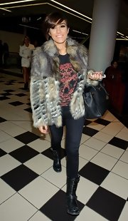 Frankie Sandford paired her fur coat with jeans and a t-shirt for a mix of glamour and casual.