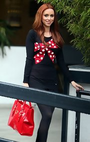 Una Healy chose this playful mini dress with polka dot bow print on the front.