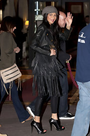 Nicole Scherzinger was spotted at Fouquet's in black leather ankle booties with fierce ridged soles.