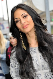 Nicole Scherzinger finished off her long locks with gold chain embellished earrings.