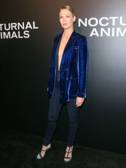January Jones toned down the sexiness of her plunging jumpsuit with a blue velvet blazer by Tom Ford when she attended the 'Nocturnal Animals' screening.