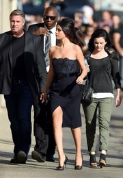 Selena Gomez made an ultra-sophisticated choice with this vintage Chanel strapless LBD, featuring a lace bodice and a thigh-baring slit, for her 'Jimmy Kimmel' appearance.