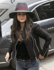 Selena Gomez finished off her look with a gray and burgundy hat by Maison Michel.