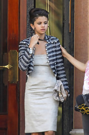 Selena Gomez looked mature in a black and white tweed jacket.