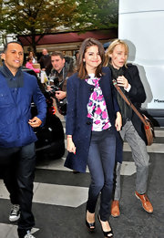 Actress and singer Selena Gomez looked ultra chic in a navy blue wool coat.