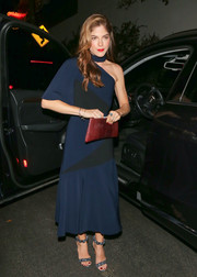 Selma Blair tied her look together with a red snakeskin clutch.