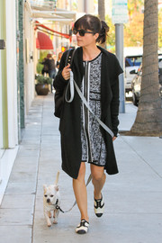Selma Blair stepped out with her dog in a Stormy Knit Dress by Parker paired with an oversized cardigan and oxford flats.