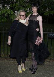 Erin O'Connor, at the Serpentine Gallery Summer Exhibition, paired her black dress with matching black platform evening sandals with criss-cross straps.