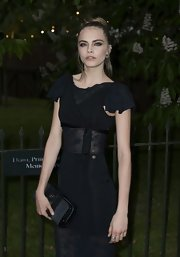 Cara Delevingne carried a zip-around clutch at the Serpentine Gallery Summer Exhibition.