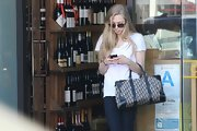Amanda Seyfried toted a Dior bag while out and about on Melrose.
