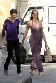 Stephanie Seymour looked breezy in a purple halter dress while out and about with her son.
