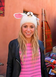 Shakira gets playful in a white knit rabbit beanie!