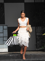 Shanina Shaik amped up the flirty feel with a tiered white skirt.