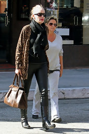 Sharon Stone took a walk on the wild side in a long leopard print cardigan and a pair of tight leather pants.