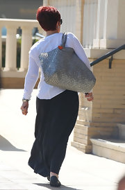 Sharon Osbourne was caught on cam shopping at Barney's carrying a large woven tote.
