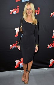 Shauna Sand looked surprisingly conservative in a long-sleeve LBD during a press conference for NRJ12.