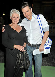 Judi Dench's pixie cut adds a bit of sass to her sophisticated style.