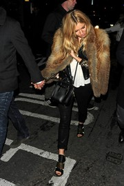 Sienna Miller wore a tan fur coat for a glamorous finish to her girls-night-out getup.