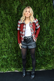Sienna Miller injected a dose of edge with a pair of black leather shorts, also by Chanel.