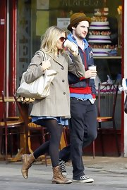 Sienna Miller sipped her coffee in a pair of distressed brown leather brogues.
