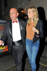 Sienna dons a cropped black blazer over her jeans and orange silk tee while leaving the theater.
