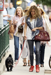 Sienna was spotted walking her dog, wearing her Louis Vuitton Denim Grunge shawl.