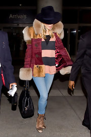 Sienna showed off her fur embellished coat while hitting LAX airport.