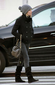 The blonde beauty looked warm weather chic in a double-breasted wool coat and a cute gray, cable knit, pompom beanie.