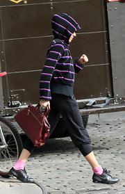 Sienna carried her red Prada Saffiano & Tessuto Tote to the gym.