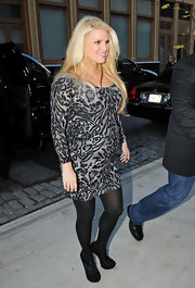 Jessica Simpson proudly showed off her growing figure in a leopard print mini and opaque tights while out in NYC.