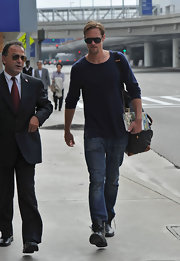 True Blood's Alexander Skarsgard strolls into LAX wearing his on-trend military inspired boots unlaced for added edge.