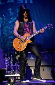 Slash amped up the edge factor with a pair of ripped black leather pants while performing in Mexico City.