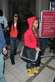Jaden Smith contrasted his red hoodie and green shirt with a pair of yellow basketball sneakers.
