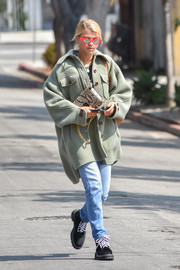 Sofia Richie continued the edgy vibe with a pair of faded jeans.