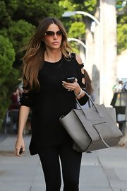 Sofia showed some shoulder in this funky black sweater while out running errands.