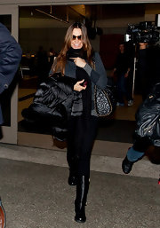 Sofia Vergara traveled in style with beau Nick Loeb in black leather flat boots with buckled detailing.