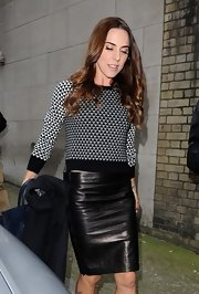 Mel C left the sporty look behind and opted for a more glam knee-length leather skirt.