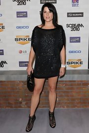 Neve Campbell showed off her enviable figure in a sparkly mini dress at Spike TV's Scream Awards.
