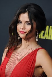 Selena Gomez opted for a slightly undone look with this loose updo with face framing waves.