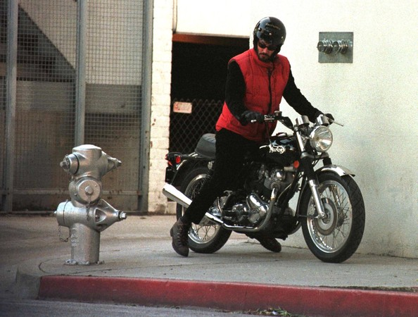 Actor Keanu Reeves was spotted out on his motorcycle, wearing a black visored helmet.