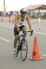 Looking like a true pro, Mario sports these wrap around, performance shades while biking in a triathalon.