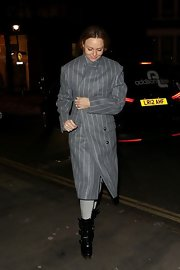 Stella McCartney chose a gray-and-white striped cool coat for her classically cool evening look.