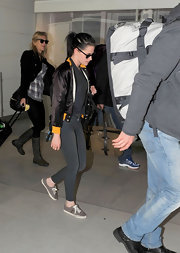 Kristen Stewart finished off her nonchalant look with a pair of gray leather sneakers.