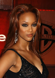 Tyra flaunted her red highlights with this sleek straightened 'do.