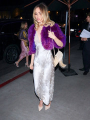 Suki Waterhouse added an extra dose of glamour with a purple fur jacket.