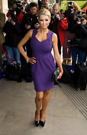 Nicola McLean arrived at the TRIC Awards 2012 in a classic cut purple dress with chic-shaped neckline.