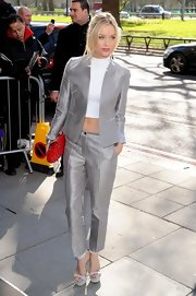 Laura Whitmore looked ultra modern at the TRIC Awards in a silver pantsuit and white platform sandals.